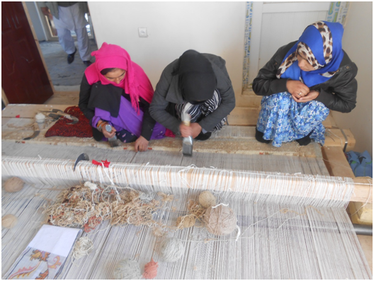 Carpet Weaving Project beneficiaries during work 2