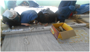 Carpet Weaving Project beneficiaries during work