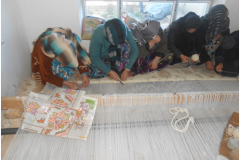 Carpet Weaving Project beneficiaries during work 3