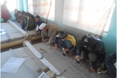 Carpet Weaving Project beneficiaries during work 7