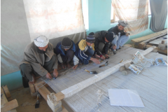 Carpet Weaving Project beneficiaries during work male 3
