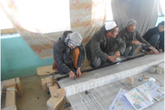 Carpet Weaving Project beneficiaries during work male 4
